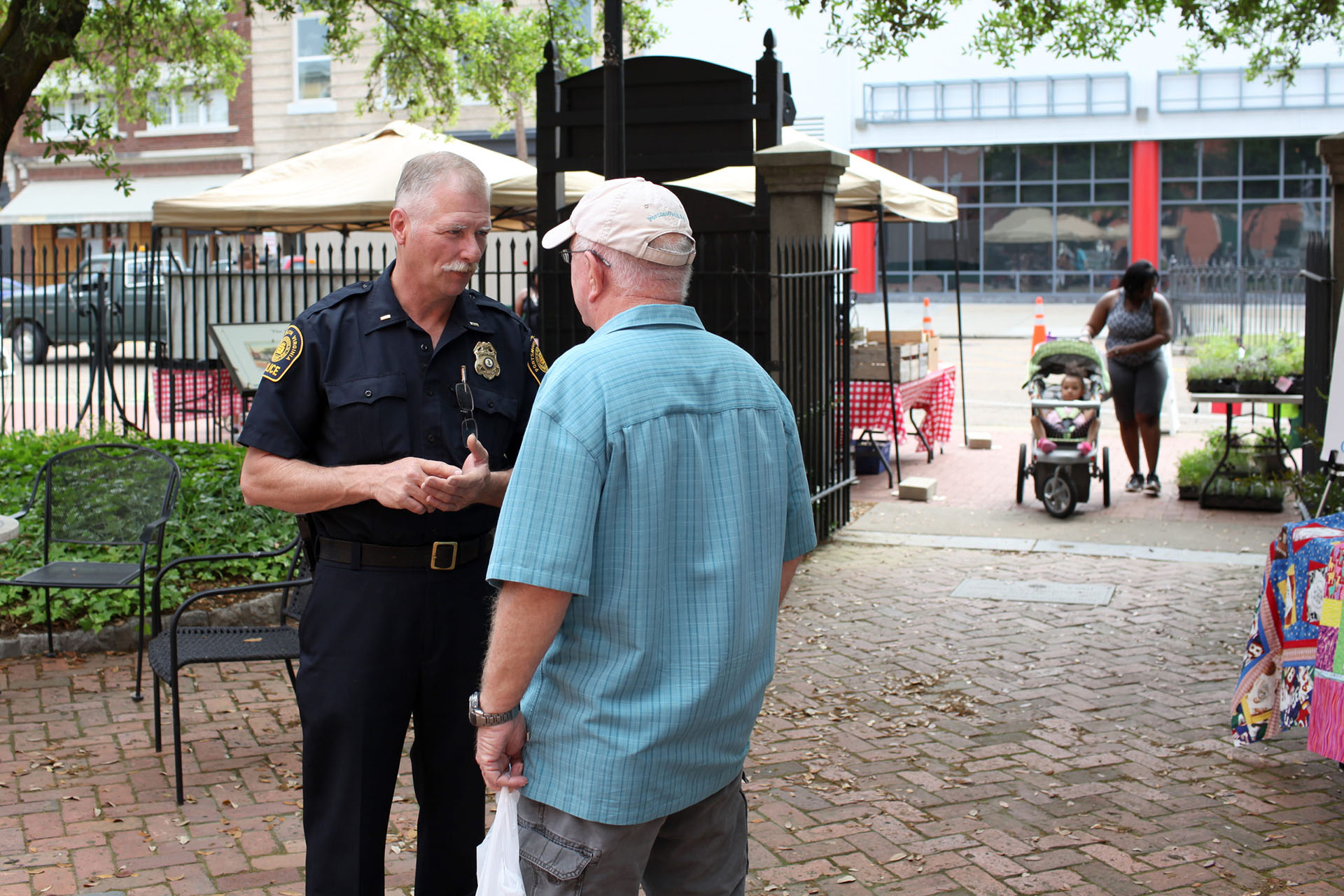 A police officer and citizen have a friendly conversation