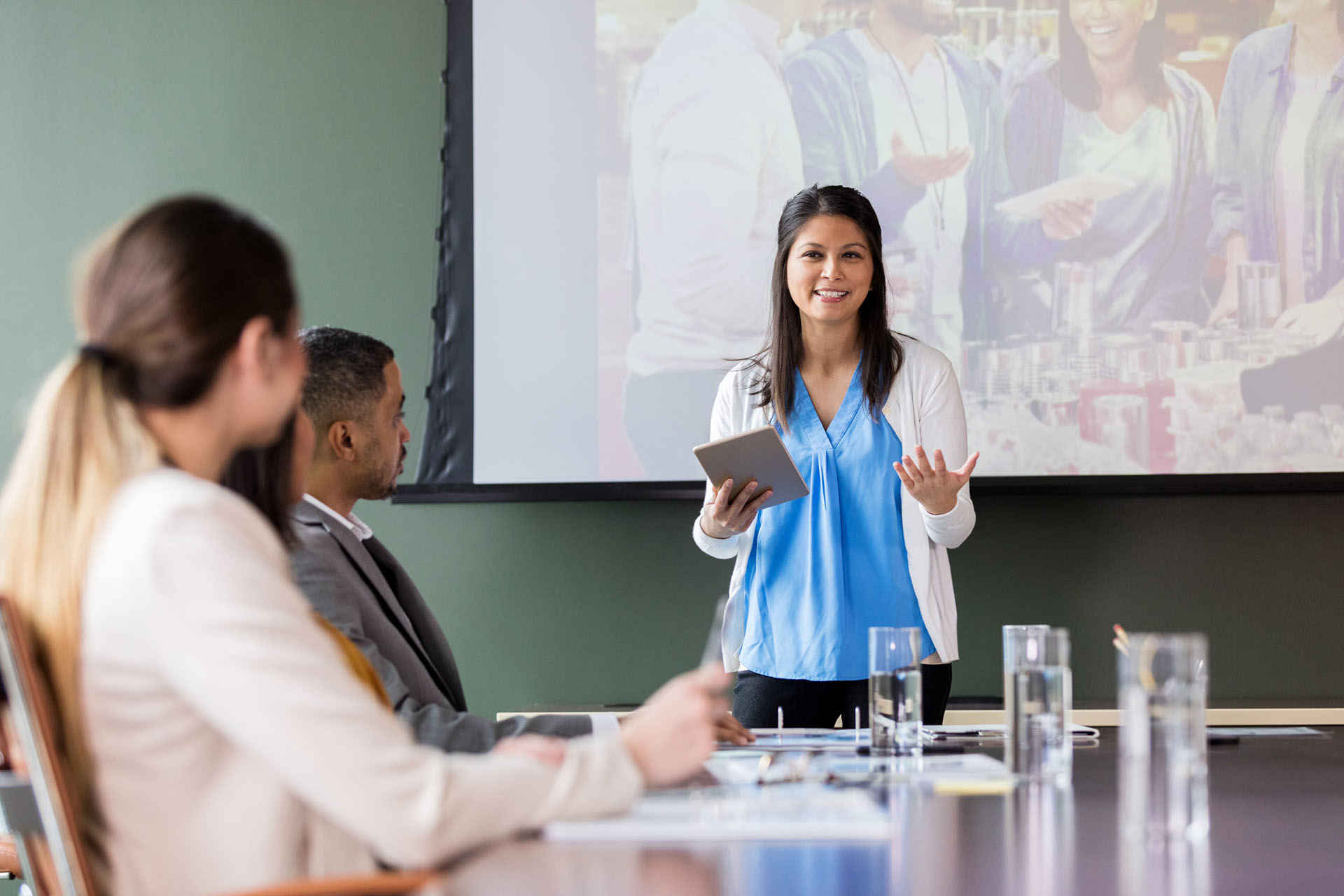A woman gives a presentation during a committee meeting