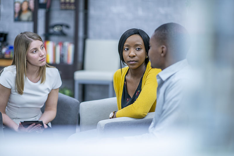 Young people listen to each other in a support group
